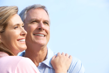 Middle-aged couple happy about borrowing money wisely
