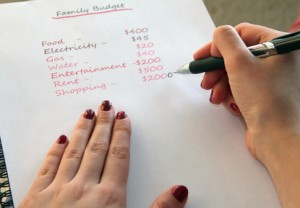 Hands of woman making a budget