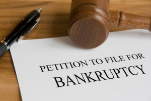 pen, gavel and petition to file for bankruptcy