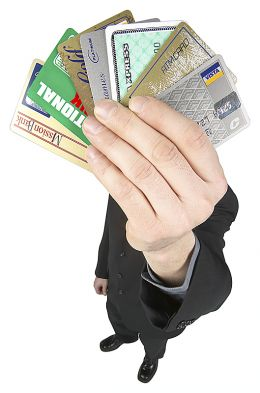 man holding multiple credit cards