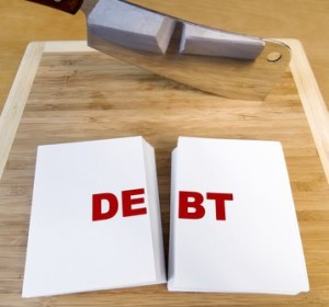 debt cut in half