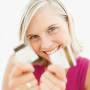 woman breaking a credit card