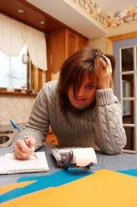 frustrated woman with a paper and calculator
